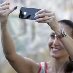 Venezuelan takes a photo of her ink-stained finger after she voted in Caracas