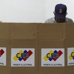 A Venezuelan wearing a Boston Red Sox cap votes in Caracas