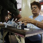 An election official stains the finger of a soldier with ink, after he voted for the successor of late Venezuelan President Hugo Chavez, in Caracas