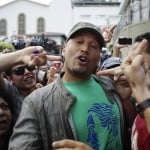 Venezuelan singer and former baseball player Alvarez is confronted by opposition candidate supporters as he arrives to vote in Caracas