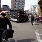 A Boston Police truck approaches the scene after explosions reportedly interrupted the running of the 117th Boston Marathon in Boston