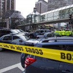 Boston Police coordinate the scene after explosions reportedly interrupted the running of the 117th Boston Marathon in Boston