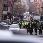 Boston Police and Firemen stand by at the scene after explosions reportedly interrupted the running of the 117th Boston Marathon in Boston
