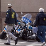 Agents from the ATF work the scene after explosions reportedly interrupted the running of the 117th Boston Marathon in Boston