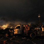 The remains of a fertilizer plant burn after an explosion at the plant in the town of West, near Waco
