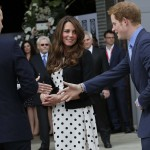 Britain's Prince William, his wife Catherine, Duchess of Cambridge, and Prince Harry, arrive for a visit to the Warner Bros. Studios at Leavesden in southern England