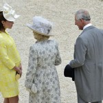 Britain's Catherine, Duchess of Cambridge speaks with Camilla, Duchess of Cornwall and Prince Charles during a garden party at Buckingham Palace in London
