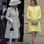 Britain's Catherine, Duchess of Cambridge walks with Camilla, Duchess of Cornwall during a garden party at Buckingham Palace in London