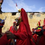 "The ""Diablos Danzantes"" of Yare wear masks as they perform a dance to mark the Feast of Corpus Christi in San Francisco de Yare"