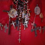 Amulets and crucifixes hang on the neck of a