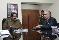 Venezuela's President Maduro chats with Venevision owner Cisneros in Caracas