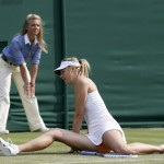 Maria Sharapova of Russia gets up after slipping during her women's singles tennis match against Michelle Larcher De Brito of Portugal at the Wimbledon Tennis Championships, in London