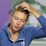 Maria Sharapova of Russia speaks at a news conference after being defeated by Michelle Larcher De Brito of Portugal in their women's singles tennis match at the Wimbledon Tennis Championships, in London