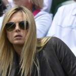 Maria Sharapova of Russia sits on court three to watch Grigor Dimitrov of Bulgaria play Grega Zemlja of Slovenia in their men's singles tennis match at the Wimbledon Tennis Championships, in London