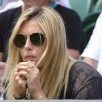 Maria Sharapova of Russia sits on court three to watch Grigor Dimitrov of Bulgaria play Grega Zemlja of Slovenia in their men's singles tennis match at the Wimbledon Tennis Championships, in London