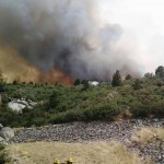 Firefighters move away from the Yarnell Hill Fire, near the town of Yarnell, Arizona in this handout photo