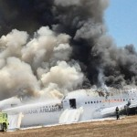 Asiana Airlines Boeing 777 is engulfed in smoke on the tarmac after a crash landing at San Francisco International Airport