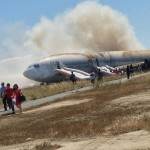Passengers evacuate the Asiana Airlines Boeing 777 aircraft after a crash landing in San Francisco