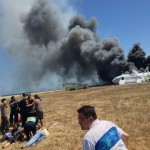 First responders tend to Asiana Airlines flight attendants and rescued passengers after flight 214 crash landed in San Francisco