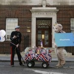 A lookalike of Britain's Prince Harry takes part in a publicity stunt in front of the door to the Lindo Wing of St Mary's Hospital, where Britain's Catherine, Duchess of Cambridge is due to give birth, in London