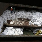 """Worker stand on top of  bags labeled """"Cuban Raw Sugar"""" inside a North Korean flagged ship """"Chong Chon Gang"""" docked at the Manzanillo Container Terminal in Colon City"""