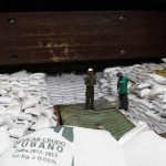 "Worker stand on top of  bags labeled ""Cuban Raw Sugar"" inside a North Korean flagged ship ""Chong Chon Gang"" docked at the Manzanillo Container Terminal in Colon City"