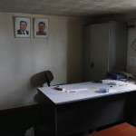 Portraits of former leader Kim Jong-il and former president Kim Il-sung are seen in one of the rooms inside a North Korean flagged ship