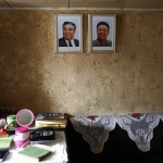 Portraits of former leader Kim Jong-il and former president Kim Il-sung are seen inside a North Korean flagged ship