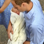 Britain's Prince William holds his baby son outside the Lindo Wing of St Mary's Hospital before leaving with Catherine, Duchess of Cambridge, in central London