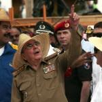 Cuba's President Raul Castro talks to Venezuela's President Nicolas Maduro and Uruguay's President Jose Mujica during an event marking the 1953 assault on the Moncada military barracks in Santiago de Cuba
