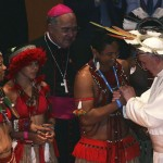 Pope Francis meets with native Brazilians during an encounter with representatives of the civil society in the Municipal Theater in Rio de Janeiro