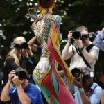 A model poses for photographers during the annual World Bodypainting Festival in Poertschach