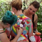 Artists paint a model during the annual World Bodypainting Festival in Poertschach