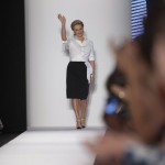 Designer Carolina Herrera waves to the audience after the presentation of her Spring/Summer 2014 collection during New York Fashion Week