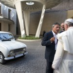 Pope Francis is presented with a Renault 4 car during a private audience with Don Zocca at the Vatican