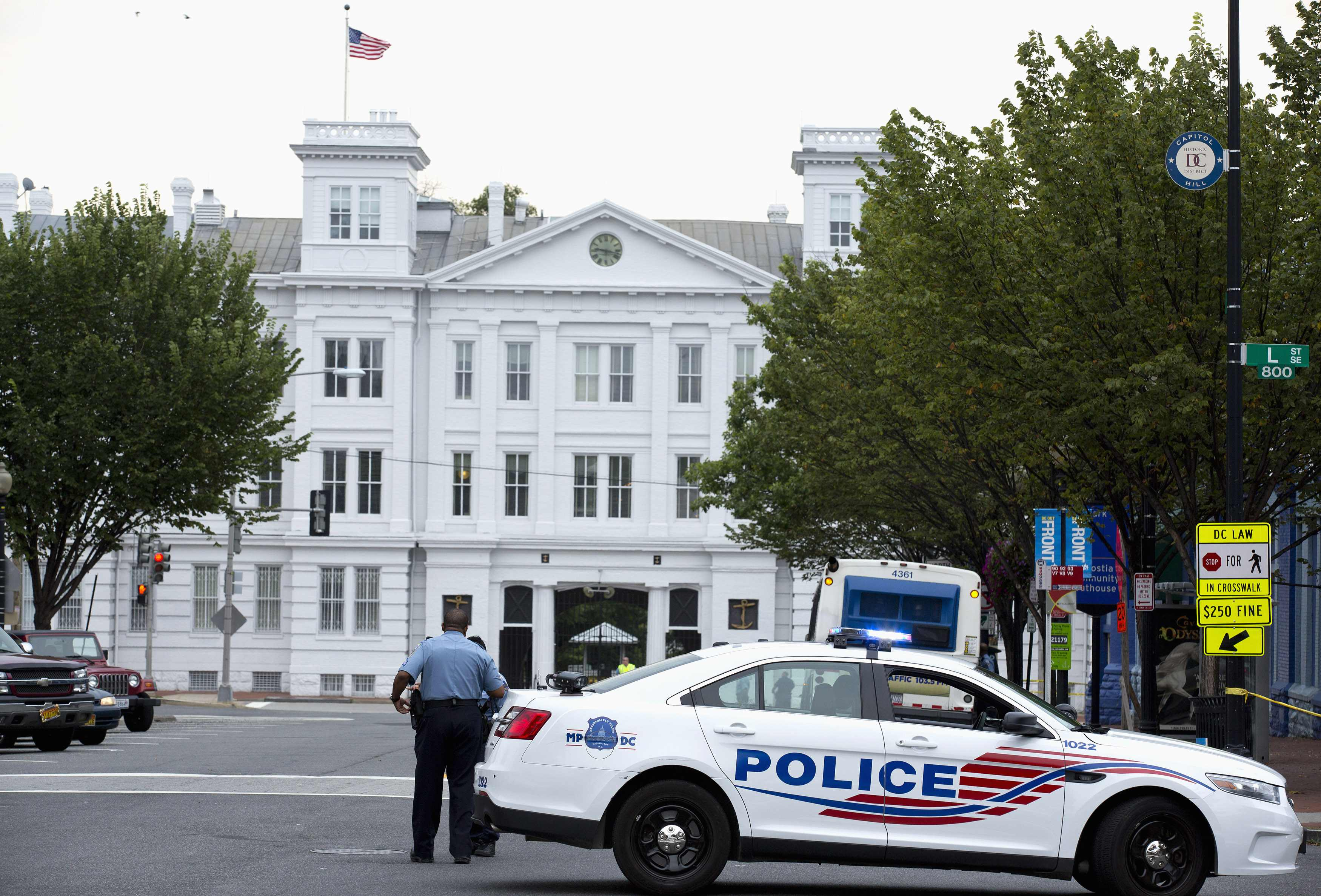 A police vehicle is seen as police respond to a shooting at the Washington Navy Yard, in Washington