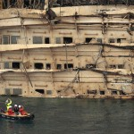 """The damaged side of the capsized cruise liner Costa Concordia is seen at the end of the """"parbuckling"""" operation outside Giglio harbour"""