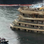"The damaged side of the capsized cruise liner Costa Concordia is seen at the end of the ""parbuckling"" operation outside Giglio harbour"