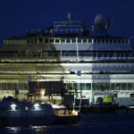 """The capsized cruise liner Costa Concordia is seen at the end of the """"parbuckling"""" operation outside Giglio harbour"""