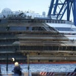"The capsized cruise liner Costa Concordia is seen at the end of the ""parbuckling"" operation outside Giglio harbour"