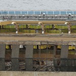 The damaged side of the capsized cruise liner Costa Concordia is seen at the end of the