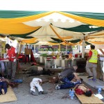 People help injured victims next to dead bodies after a shooting spree at Westgate shopping centre in Nairobi,