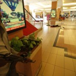 A body is seen as an armed police searches through a shopping centre for gunmen in Nairobi