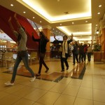 Shoppers and shop assistants raise their hands as they are escorted to safety while armed police hunt gunmen who went on a shooting spree in Westgate shopping centre in Nairobi