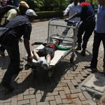 A child is wheeled out of the Westgate Shopping Centre on a trolley, after gunmen went on a shooting spree in Nairobi