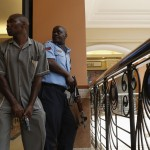 Police officers try to secure an area inside the Westgate Shopping Centre where gunmen went on a shooting spree, in Nairobi