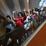 Civilians escape an area at the Westgate Shopping Centre in Nairobi