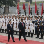 Venezuela's President Nicolas Maduro and Chinese President Xi Jinping inspect honour guards at a welcoming ceremony outside the Great Hall of the People in Beijing