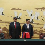 Chinese President Xi Jinping and Venezuela's President Nicolas Maduro attend a signing ceremony in the Great Hall of the People, in Beijing