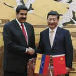 Chinese President Xi Jinping and Venezuela's President Nicolas Maduro shake hands during a signing ceremony in the Great Hall of the People, in Beijing
